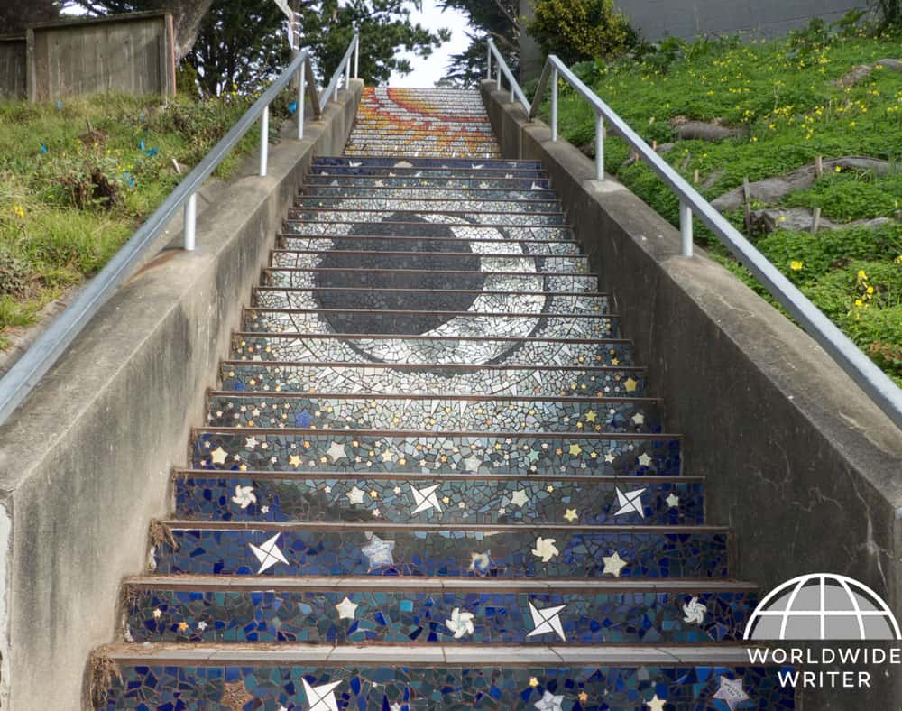 Mosaic of moon, sun and stars on tiled steps