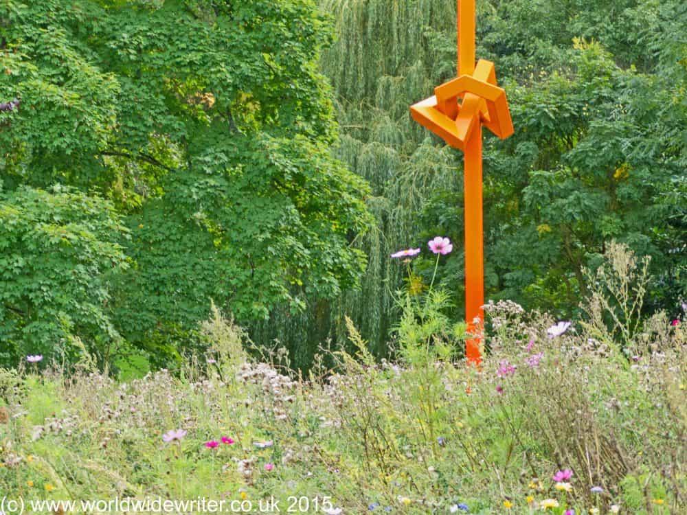 Orange sculpture in the wildflower garden