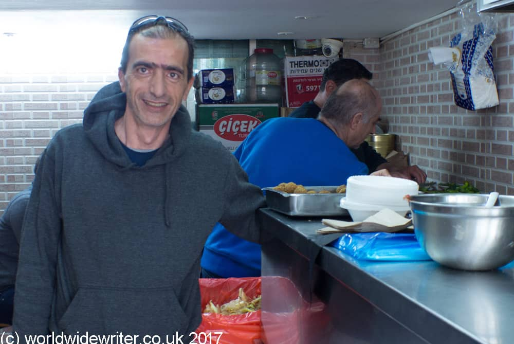 The owner of a local hummus shop, one of the stops with BiteMojo