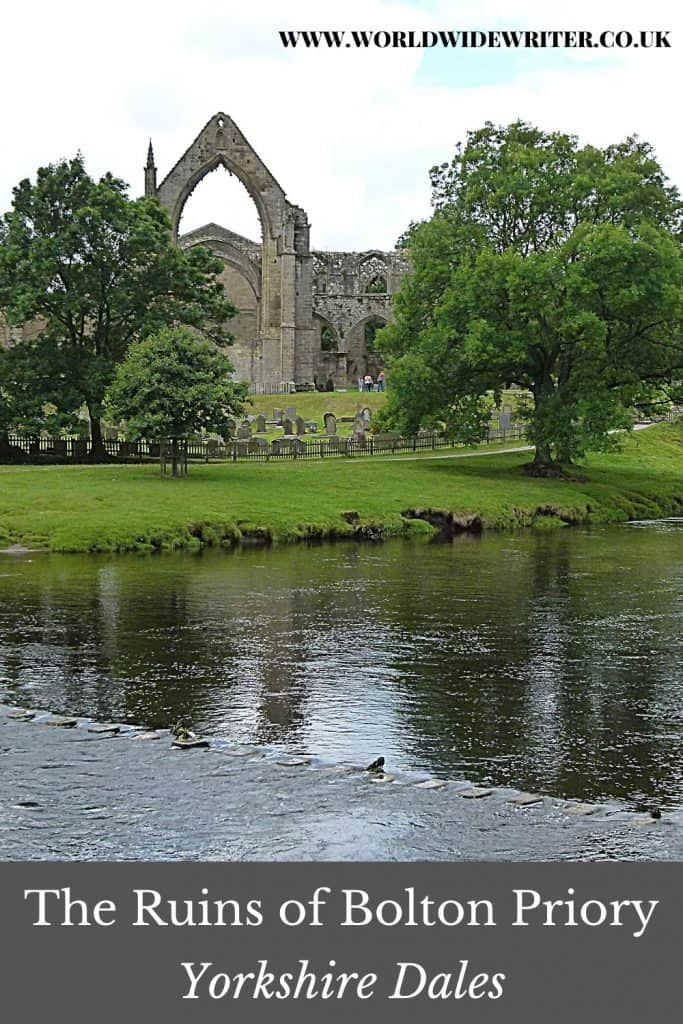 Pinnable image of Bolton Priory with water and stepping stones in front