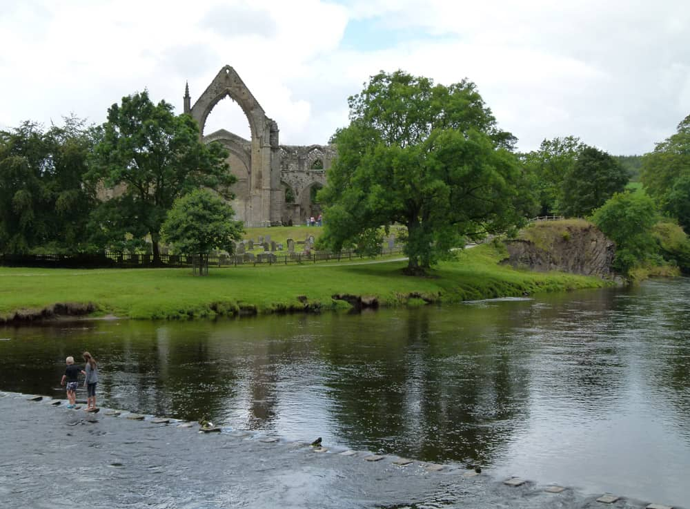 Ruined priory with water and stepping stones in front