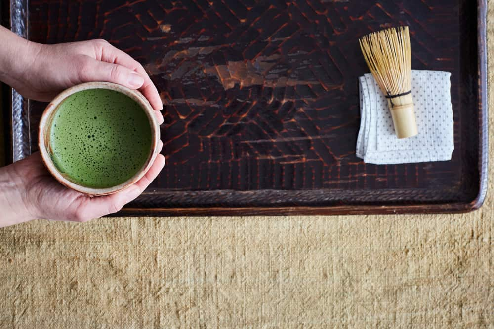 Tray with a bowl of green tea