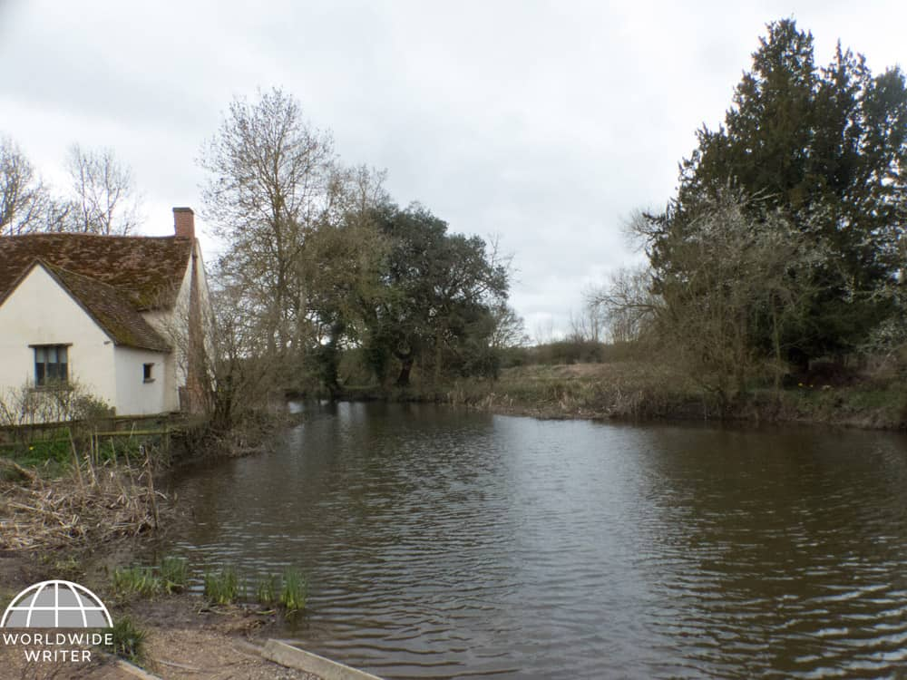 Water, trees and a house, the setting for John Constable's painting of The Haywain
