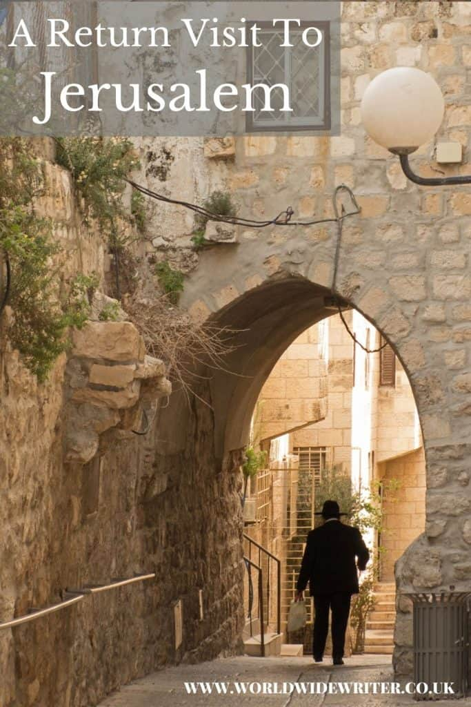 Pinnable image of a man walking through an archway in the old city of Jerusalem