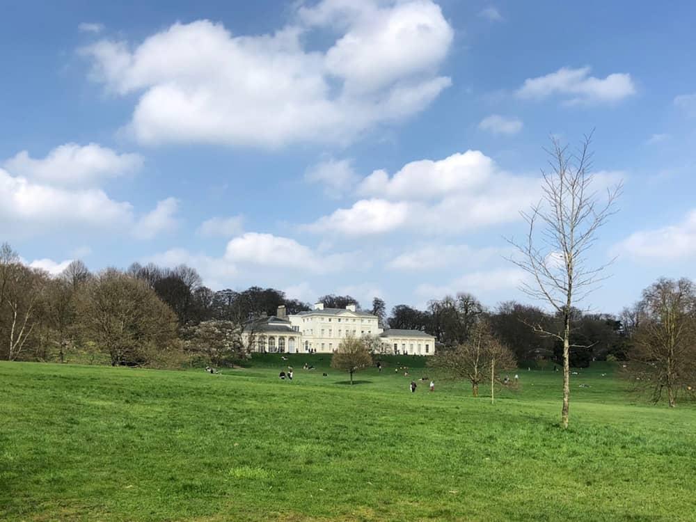Kenwood House, with Hampstead Heath and a blue sky