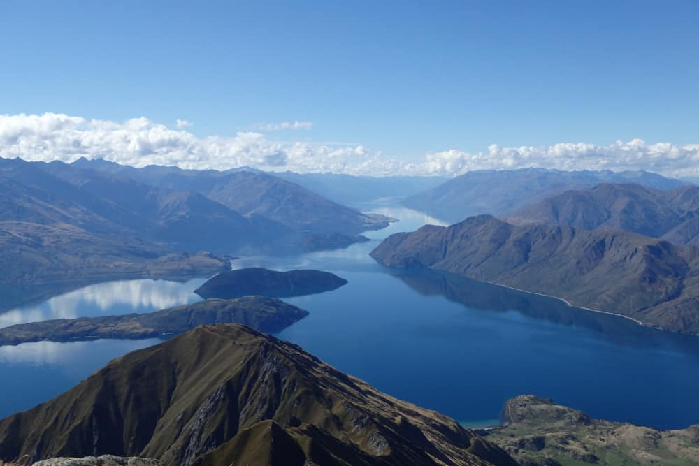 Deep blue water of Lake Wanaka, surrounded by mountains
