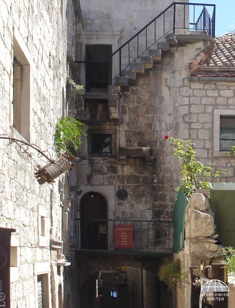 Outside of the Marco Polo House, with narrow passageway and outside stairs