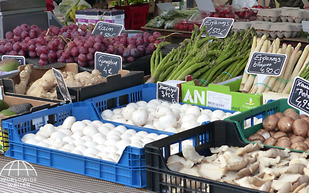 Market stall with mushrooms, asparagus and grapes