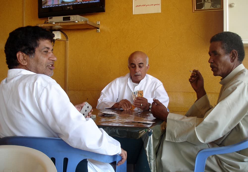 Men playing cards in a cafe