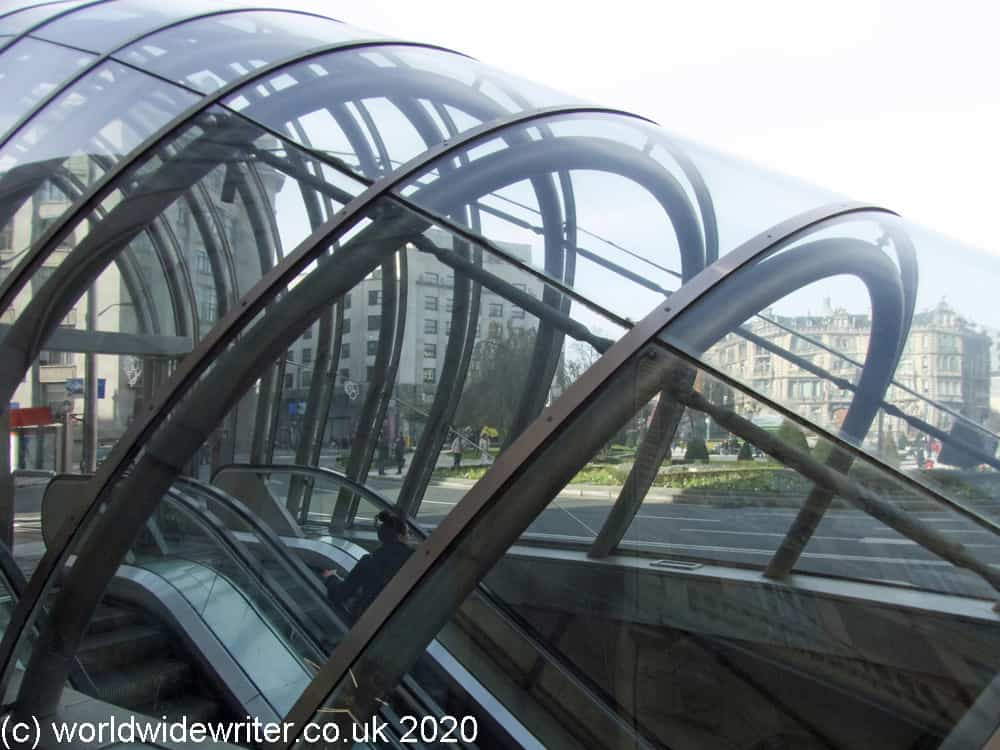 Curved glass exterior of a metro station