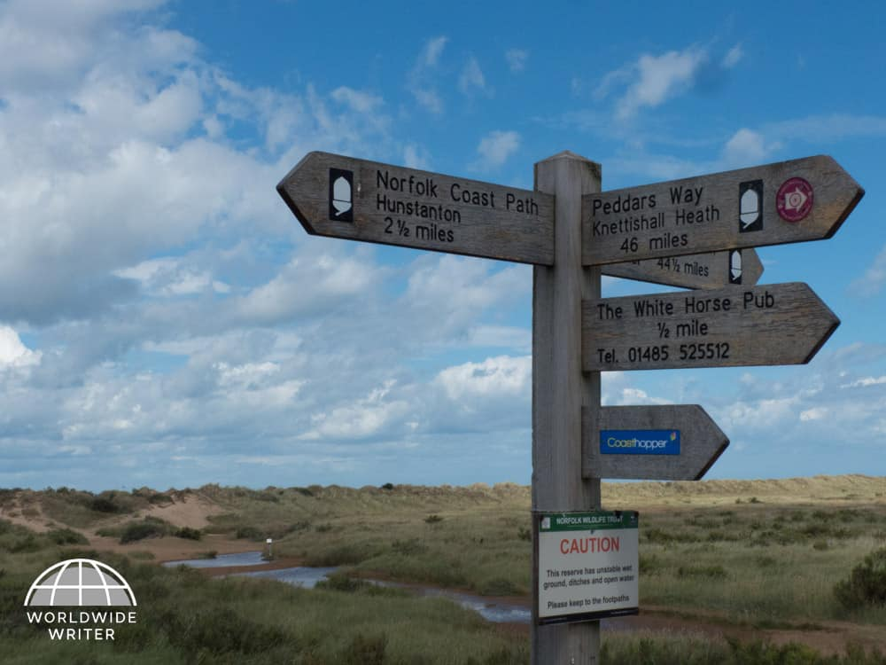 Signpost showing walks along the Norfolk coast