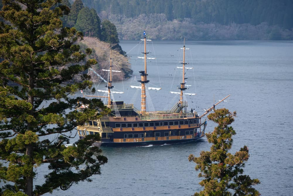 Hakone pirate ship on the lake, surrounded by trees