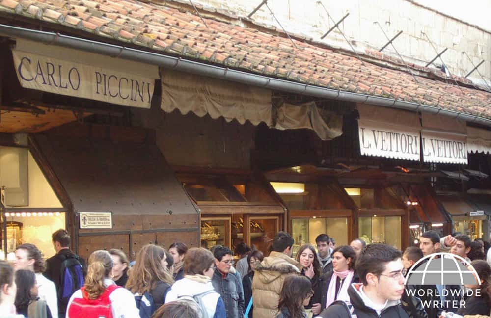 Crowds of people on the Ponte Vecchio in Florence