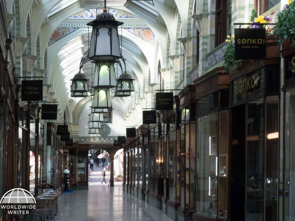 Victorian shopping arcade with high ceiling and ornate decor
