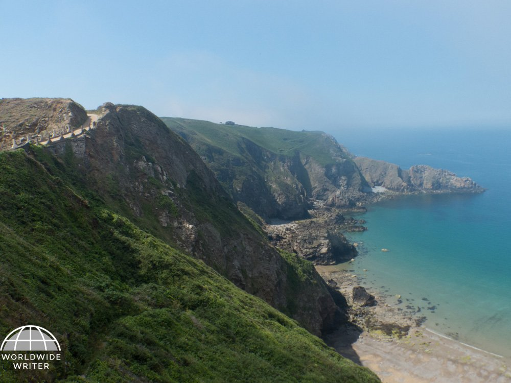 Grassy cliffs sloping down to the sea