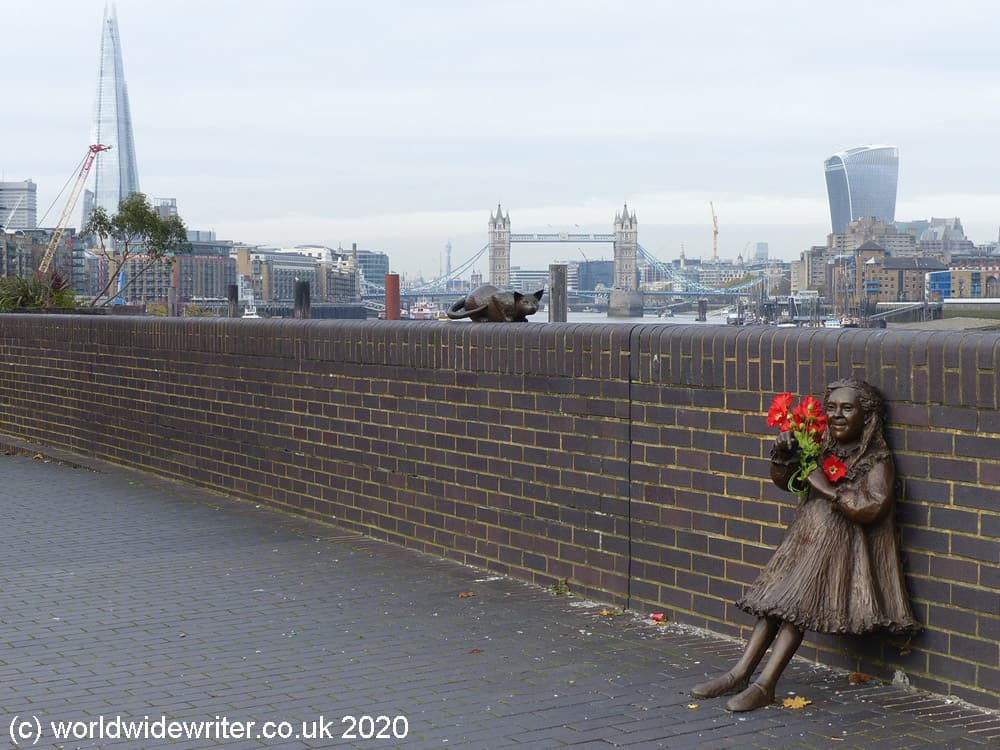 Sculpture of a girl with the London skyline in the distance