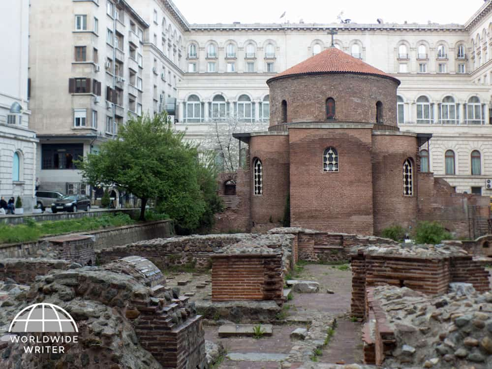 Round church with Roman remains in front