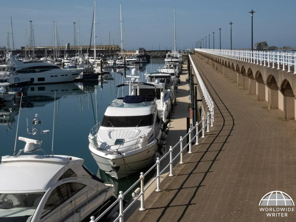 Marina with boats and a walkway