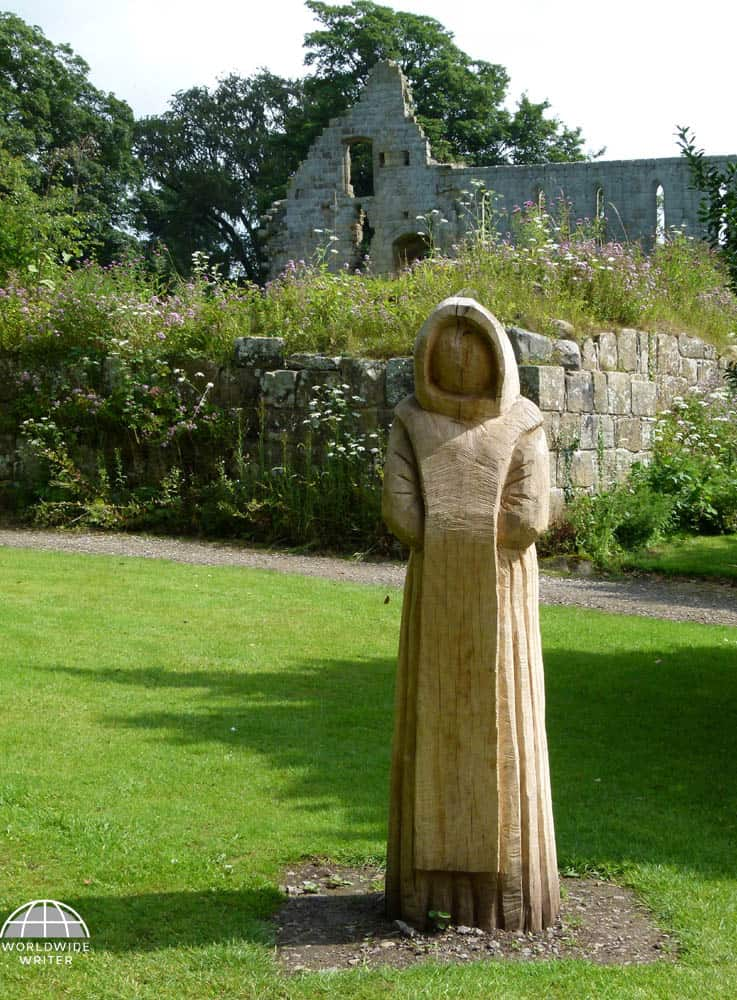 Statue of a monk in the garden of Jervaulx Abbey