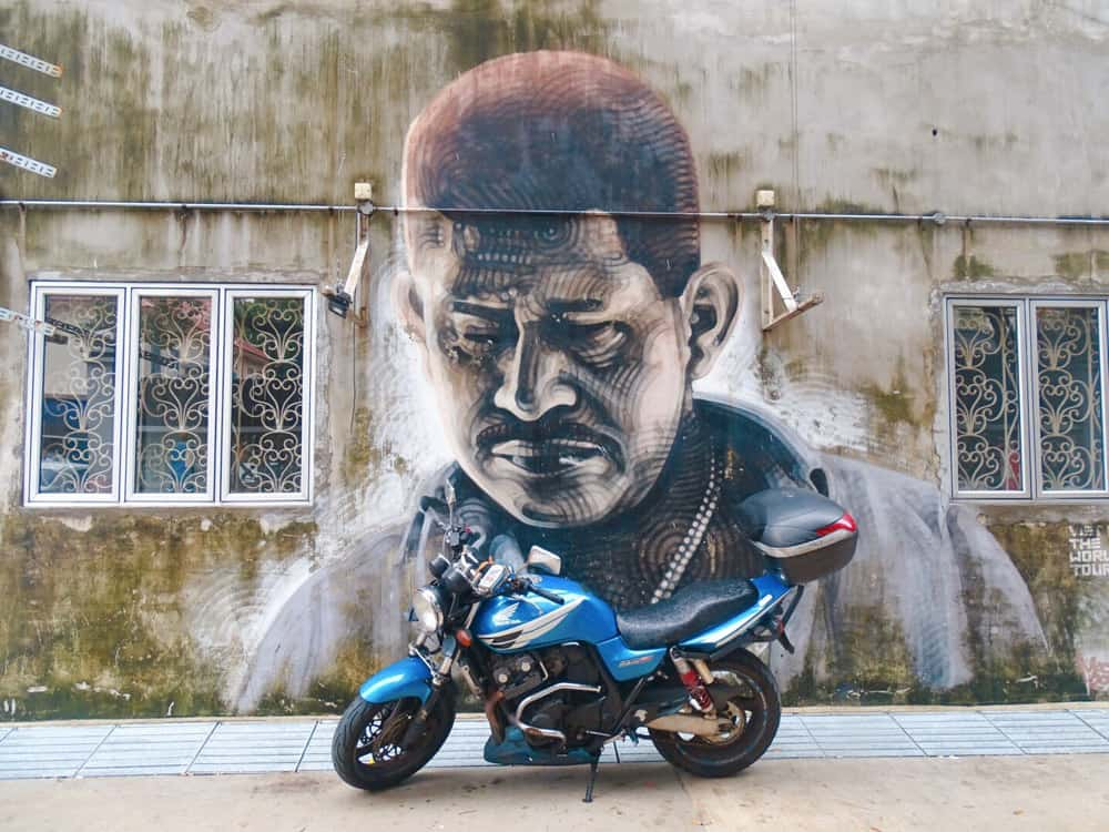 Street art image of a man and a motorbike