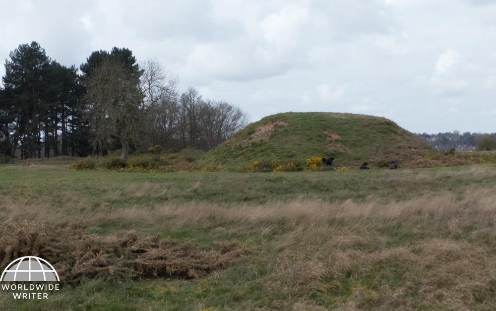 Open ground with a large burial mound