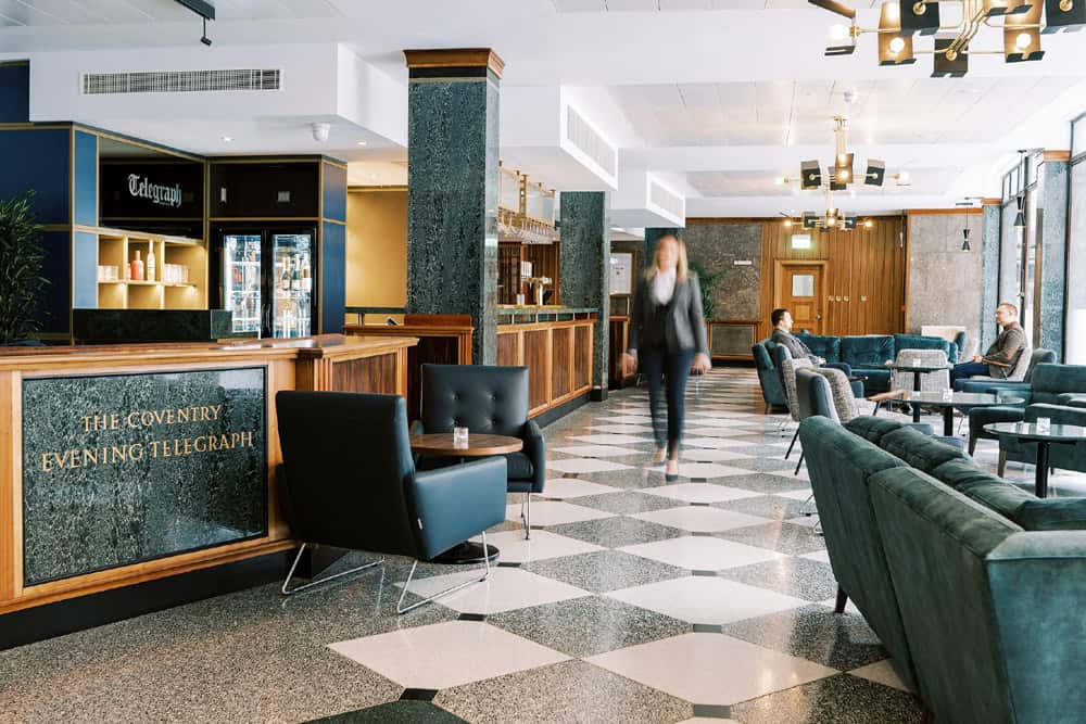 Inside the Telegraph Hotel, showing reception desk and seating area