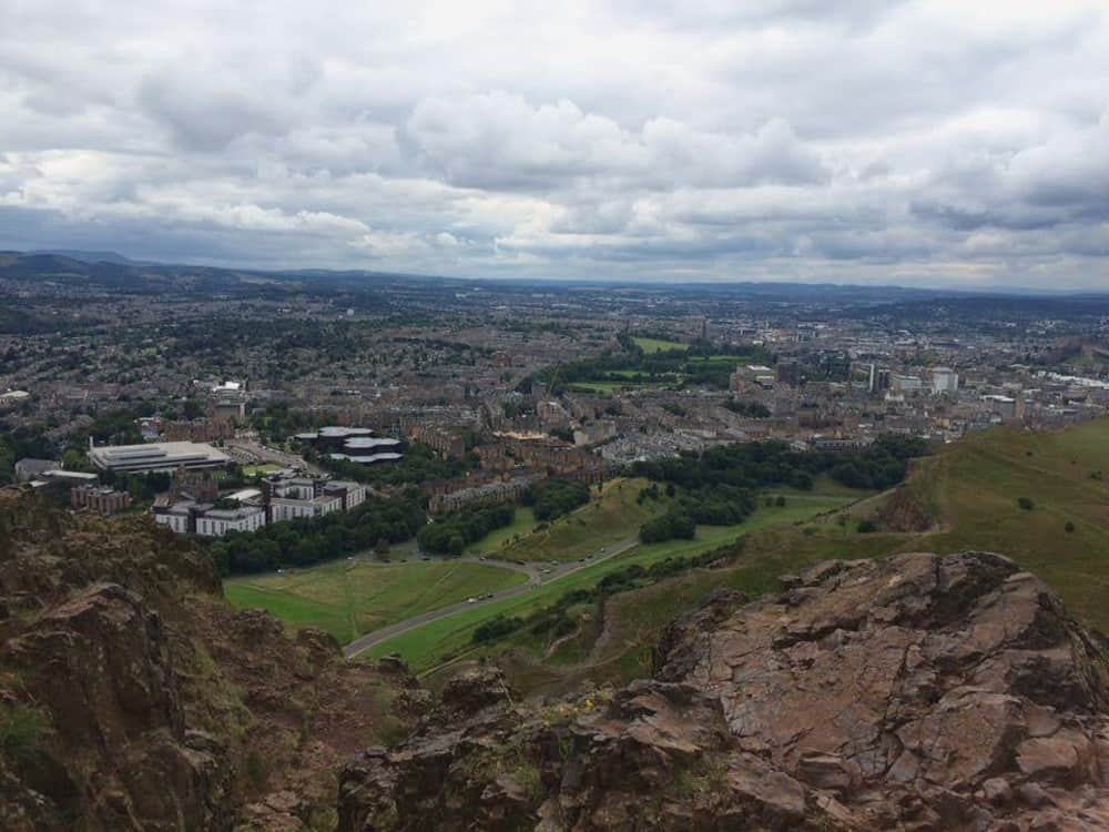 Rocky edge of Arthur's Seat, and a view across the city