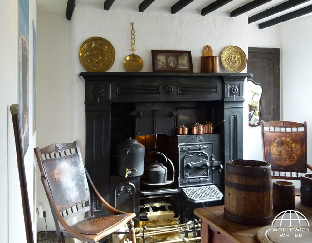 Traditional farmhouse kitchen with fireplace, chairs and table