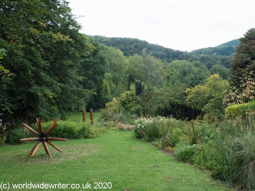 Garden with sculptures and hills