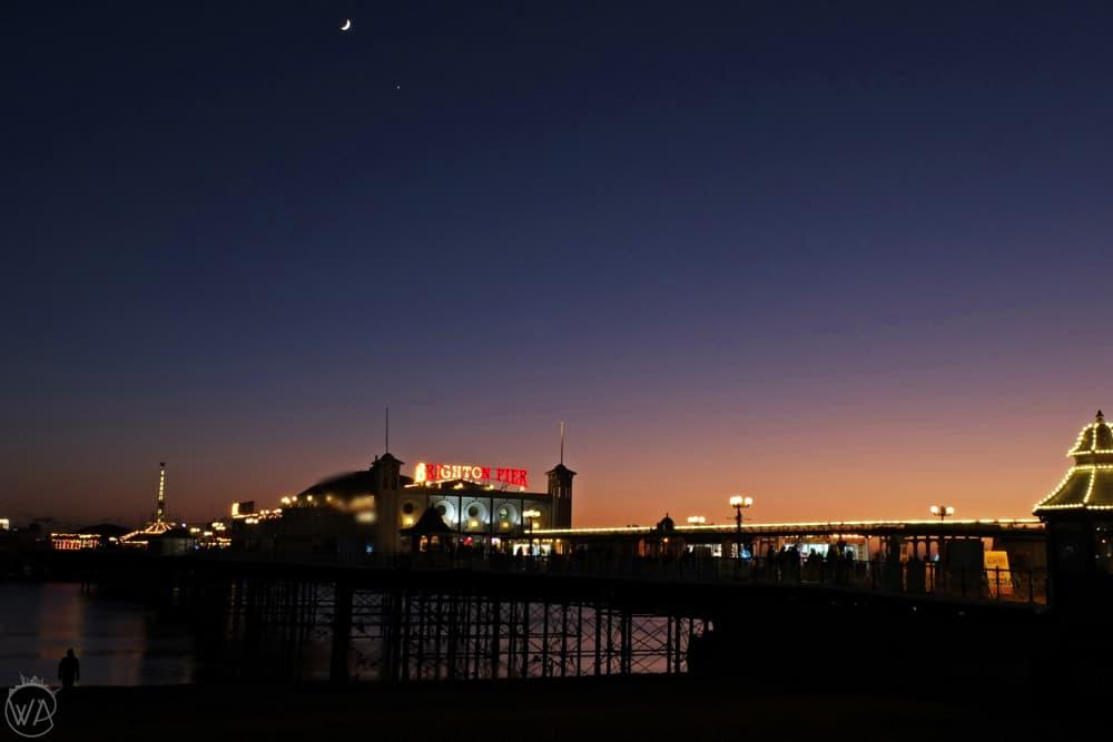 Lit up pier and night sky