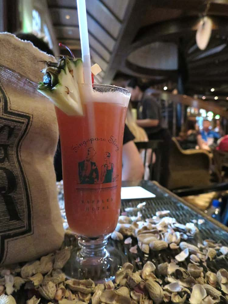 Singapore Sling cocktail with a straw