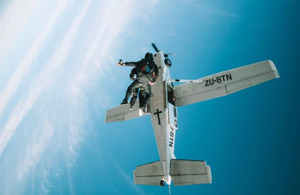 Blue sky with plane and skydiver
